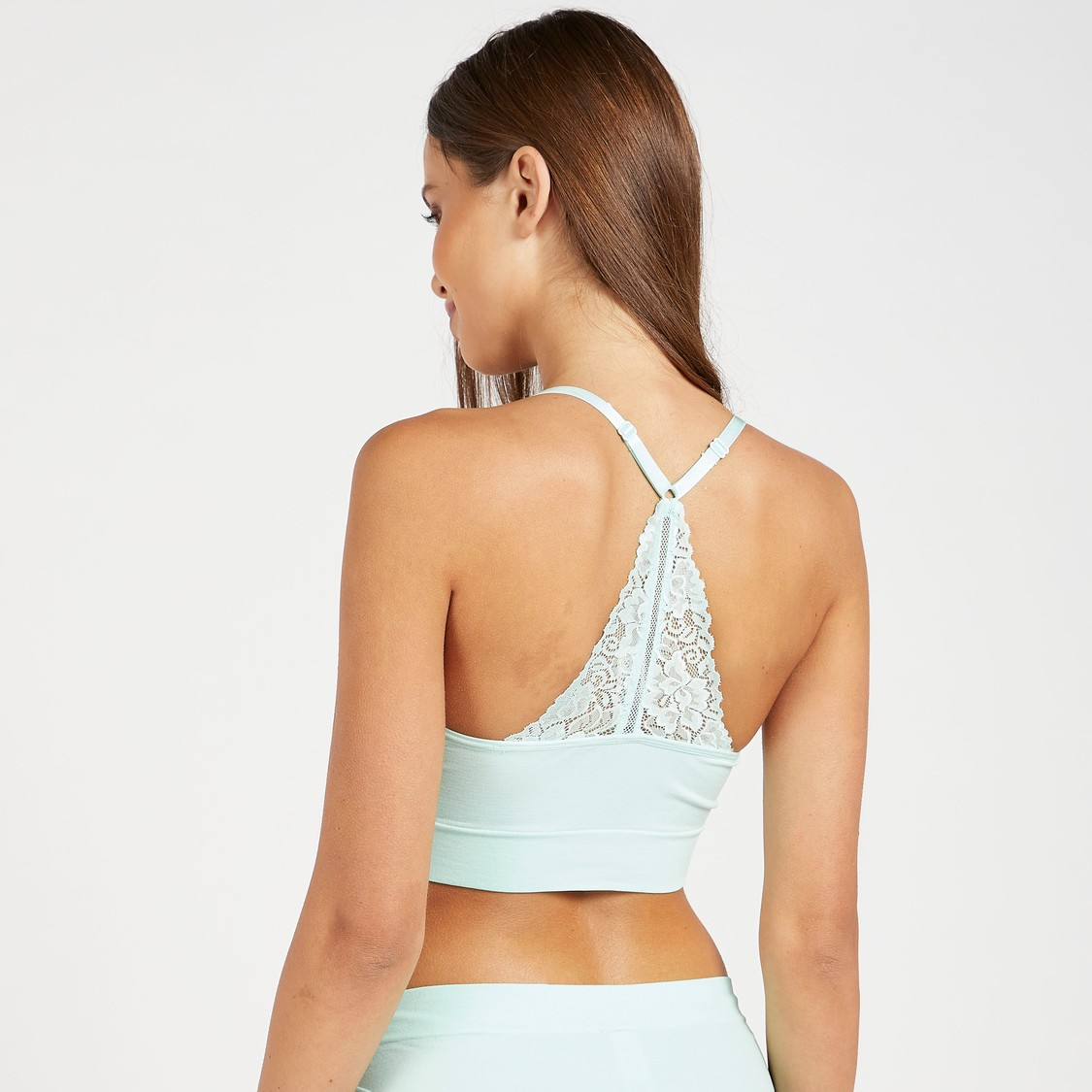 Solid Seamless Bra with Racerback and Lace Detail