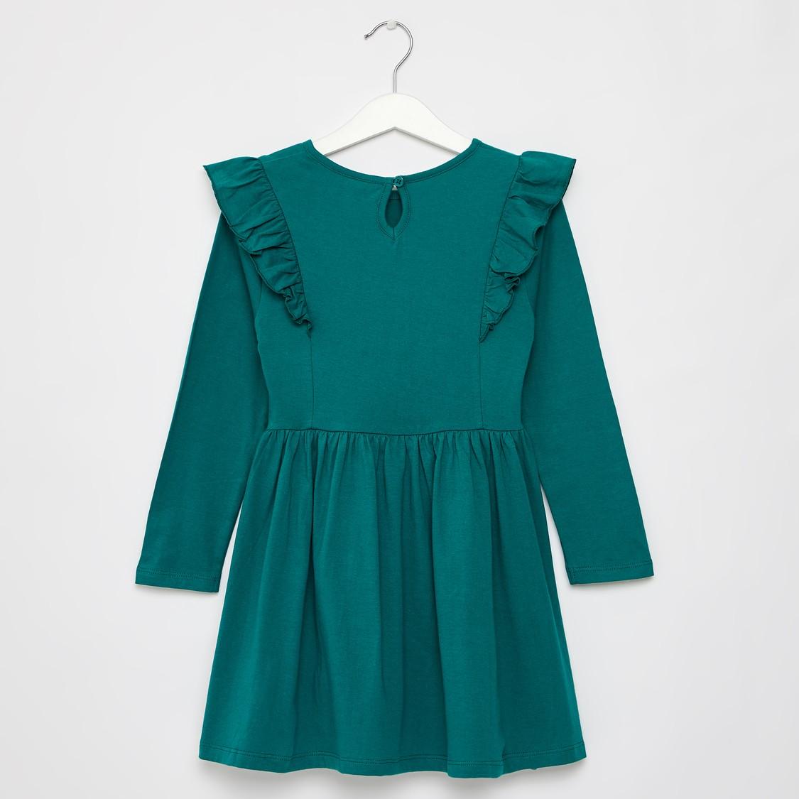 فستان بطول الركبة بياقة مستديرة وأكمام طويلة وطبعات جاسمين