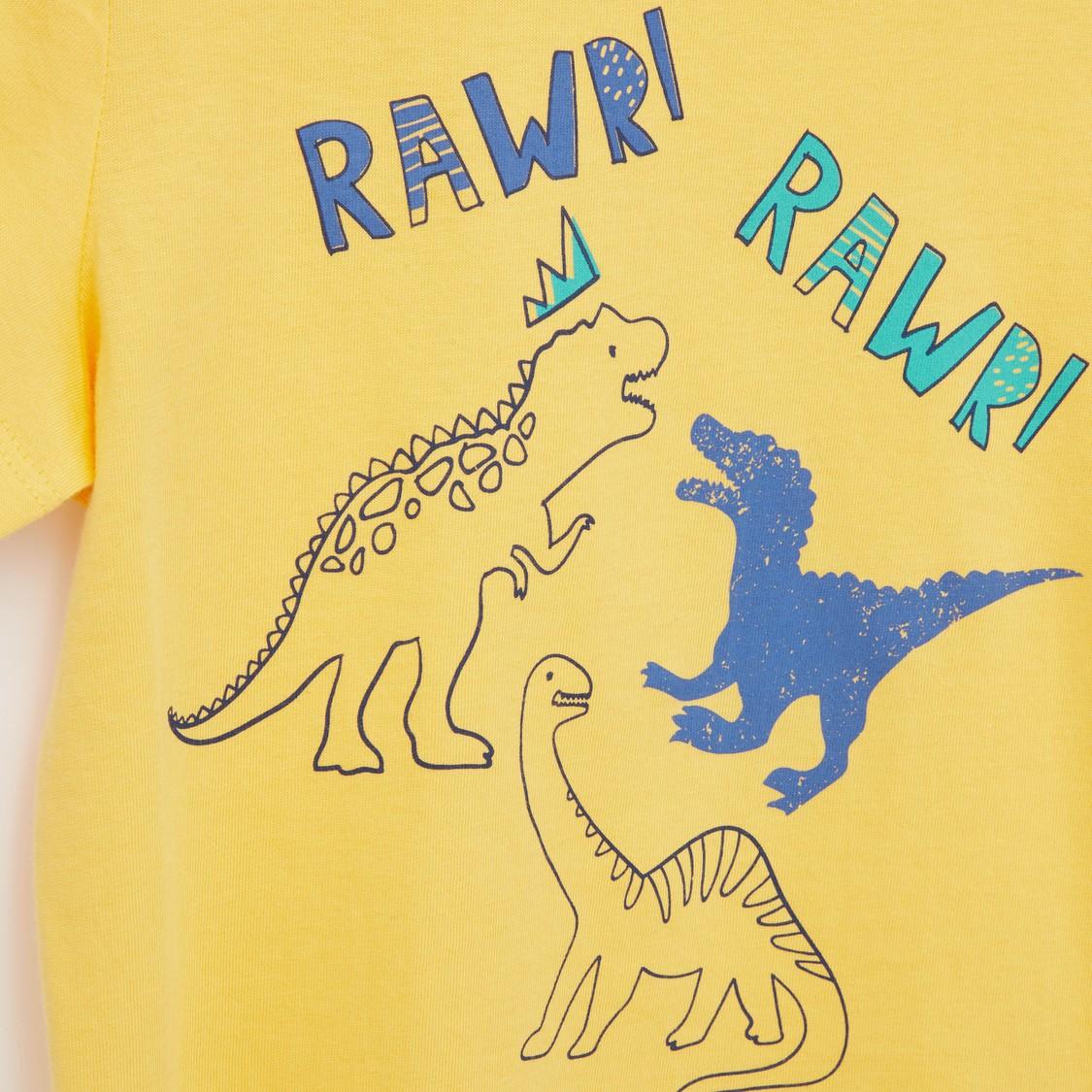 بنطلون بيجاما وتيشيرت بياقة مستديرة وطبعات ديناصور - مجموعة من قطعتين