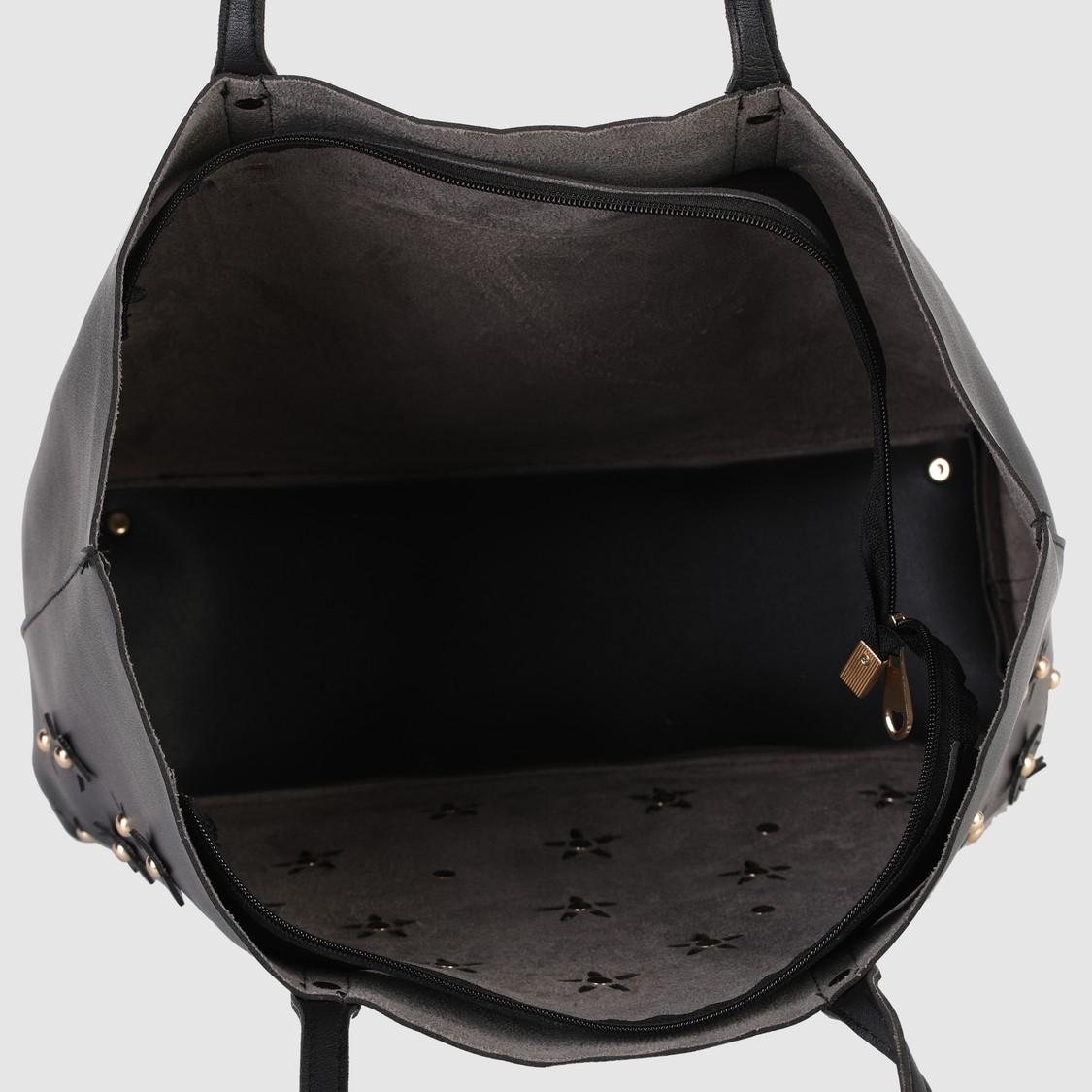 حقيبة يد بتفاصيل مفرّغة بالليزر وسحّاب