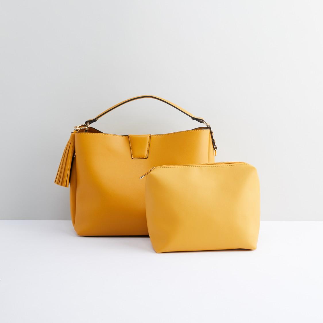 حقيبة يد بشُرّابات مع حقيبة صغيرة