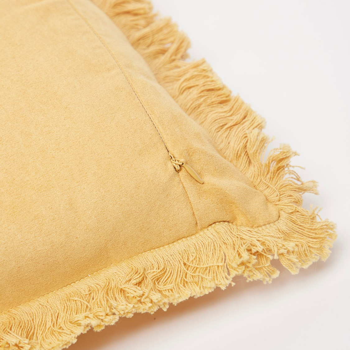 Solid Filled Cushion with Fringes - 45x45 cms