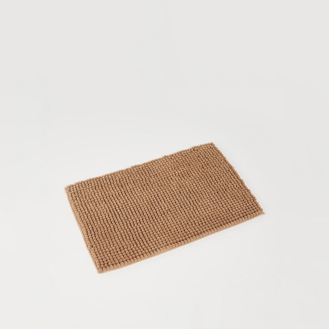 سجّادة حمّام  مستطيلة الشكل وبارزة الملمس - 70x45 × 80 سم