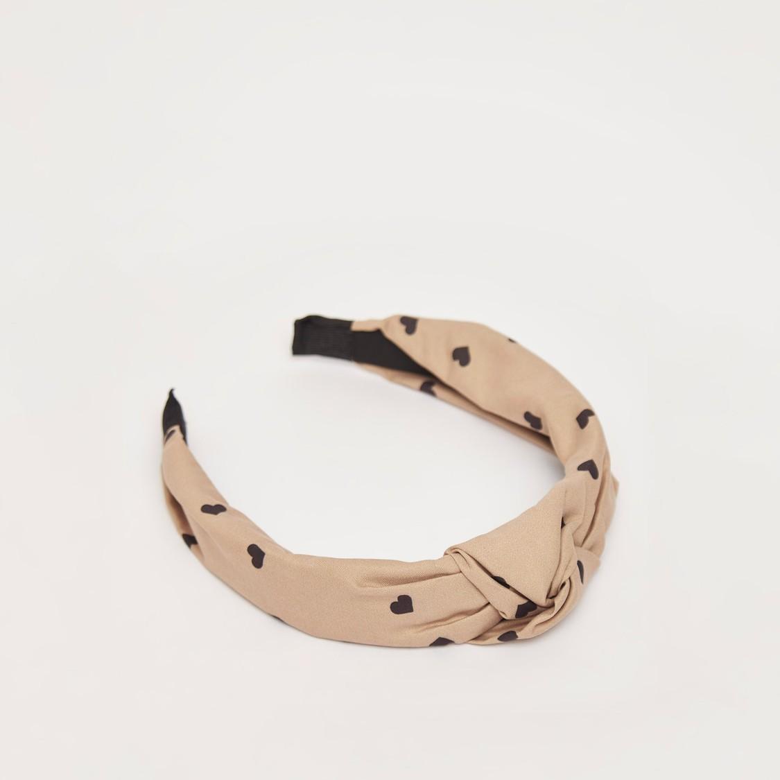 ربطة شعر بعقدة وطبعات