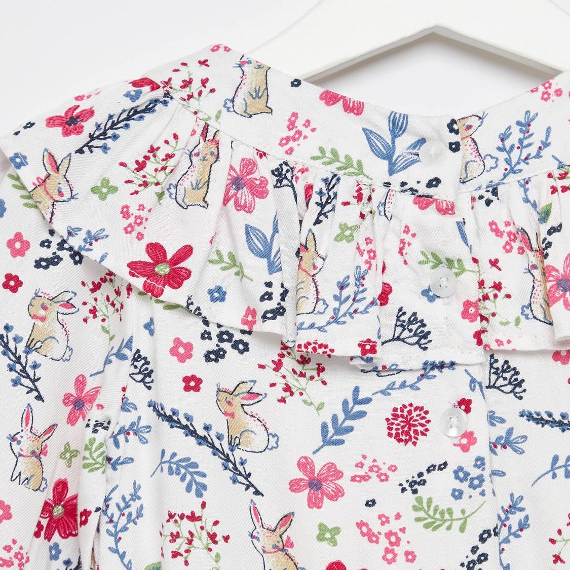 فستان بطول الركبة بأكمام طويلة وتفاصيل كشكش و طبعات أزهار