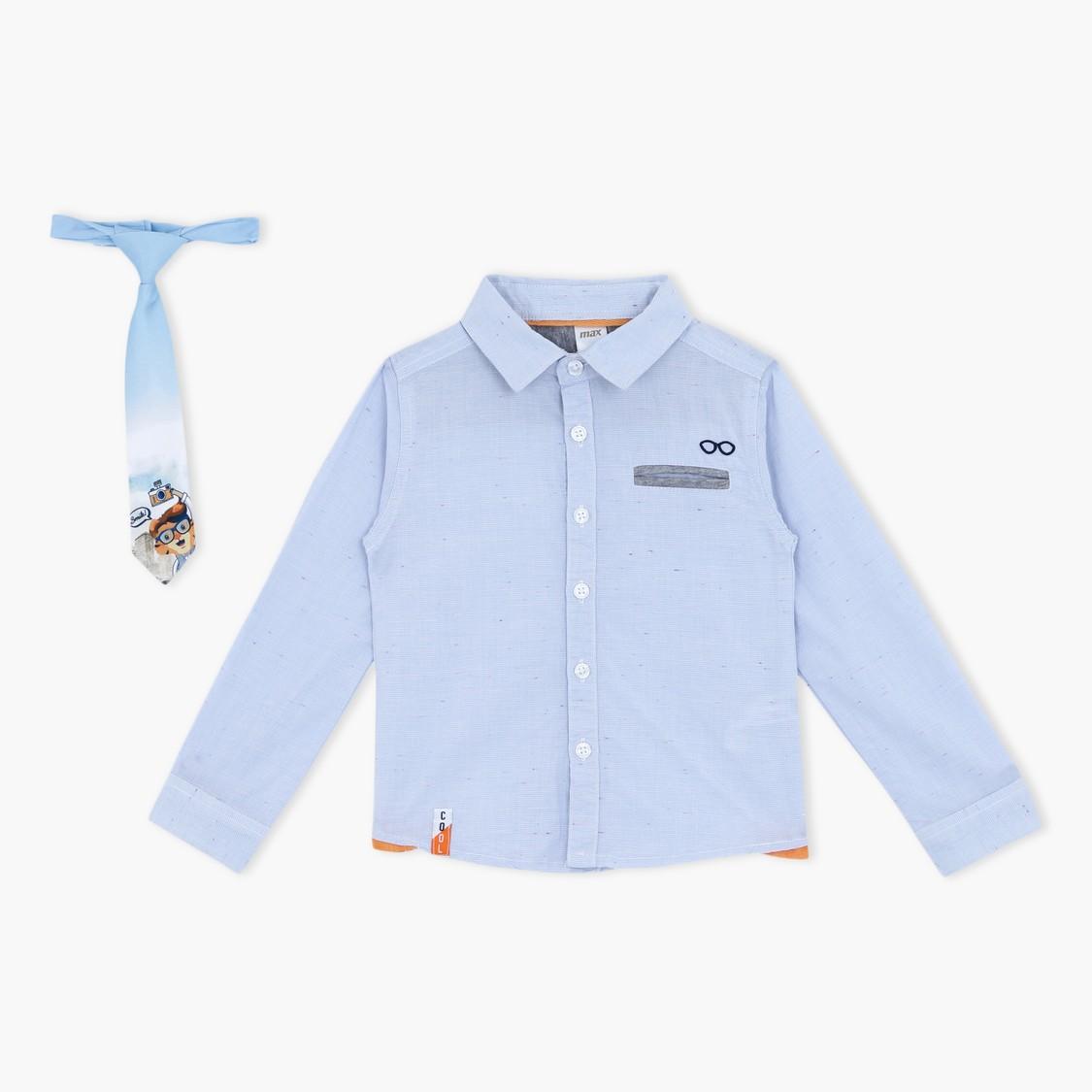 طقم مكوّن من قميص بأكمام طويلة وربطة عنق