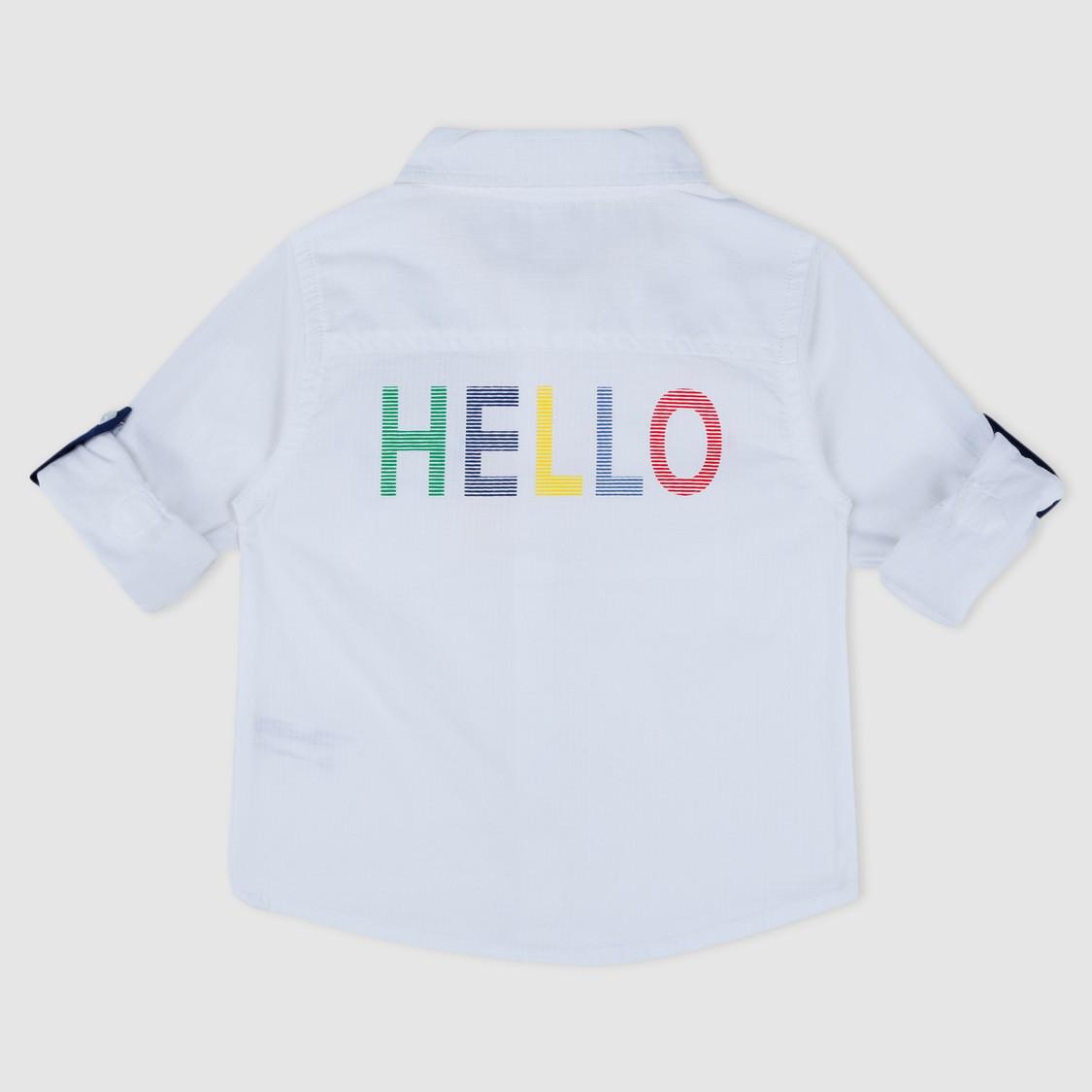 قميص بطبعات وتفاصيل جيوب وألسنة تثبيت