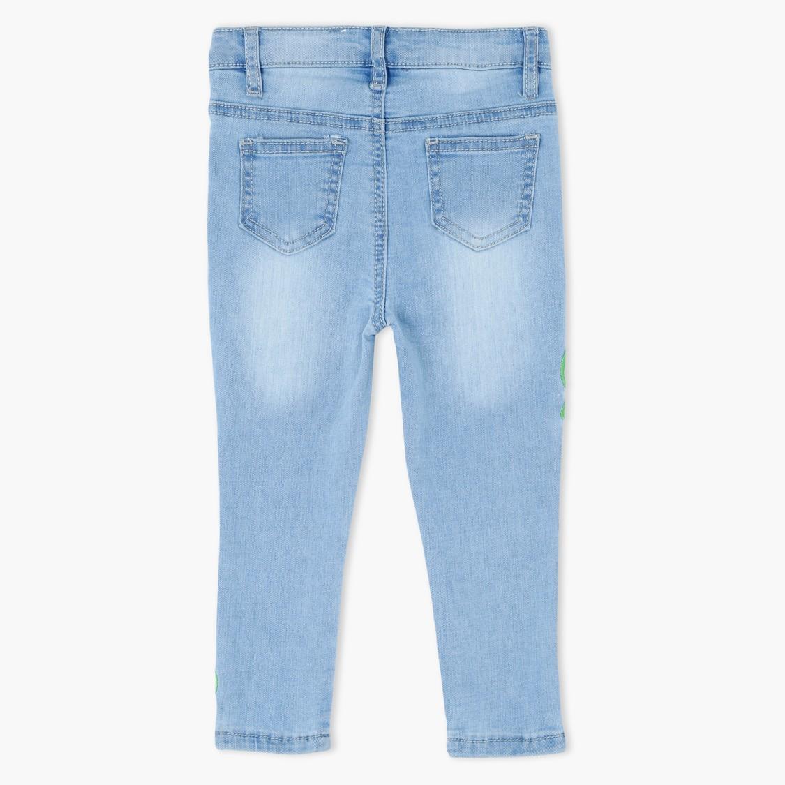 بنطال جينز طويل مزخرف مع أزرار إغلاق