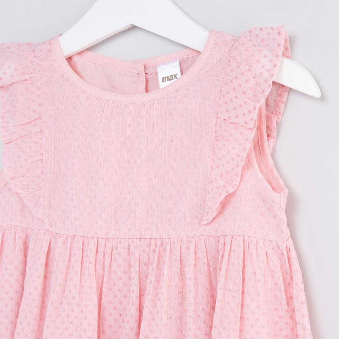 فستان بياقة مستديرة وتفاصيل كشكش وطبعات