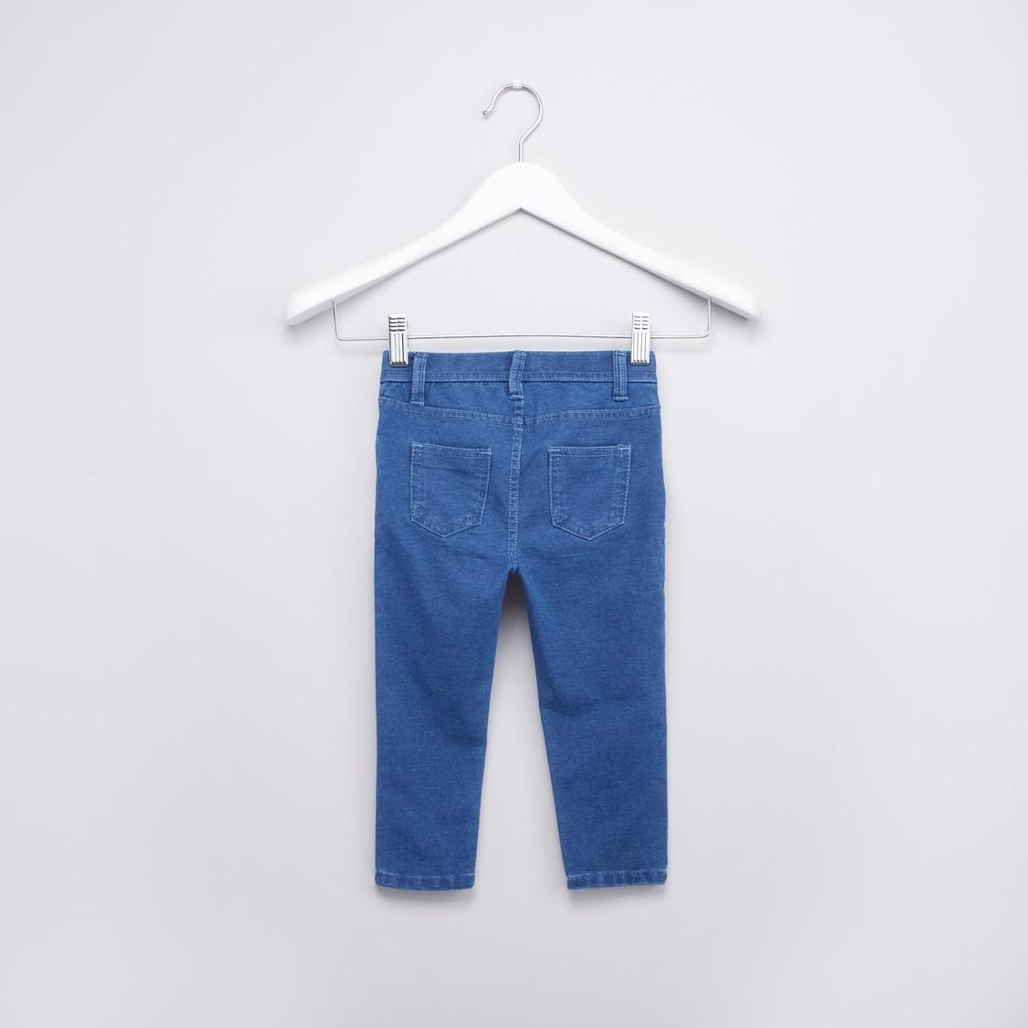 بنطلون جينز طويل بارز الملمس وجيوب وطية