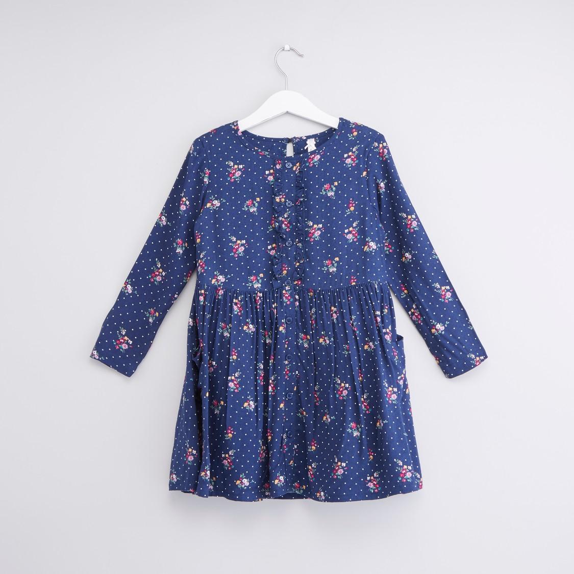 فستان بأكمام طويلة وتفاصيل كشكش وطبعات زهرية