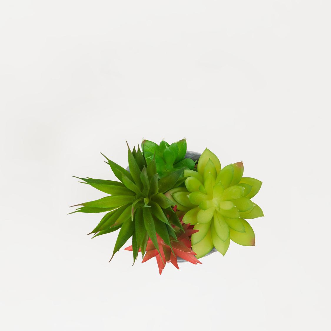 نبتة عصاري اصطناعية مع وعاء بارز الملمس