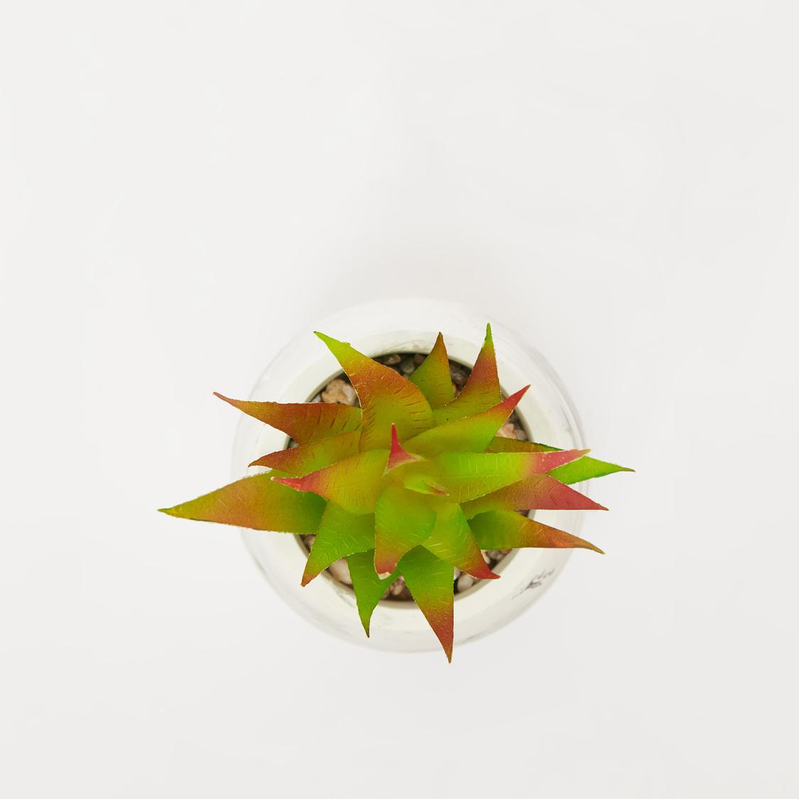 نبات عصاري صناعي في إصيص بطبعات رخامية