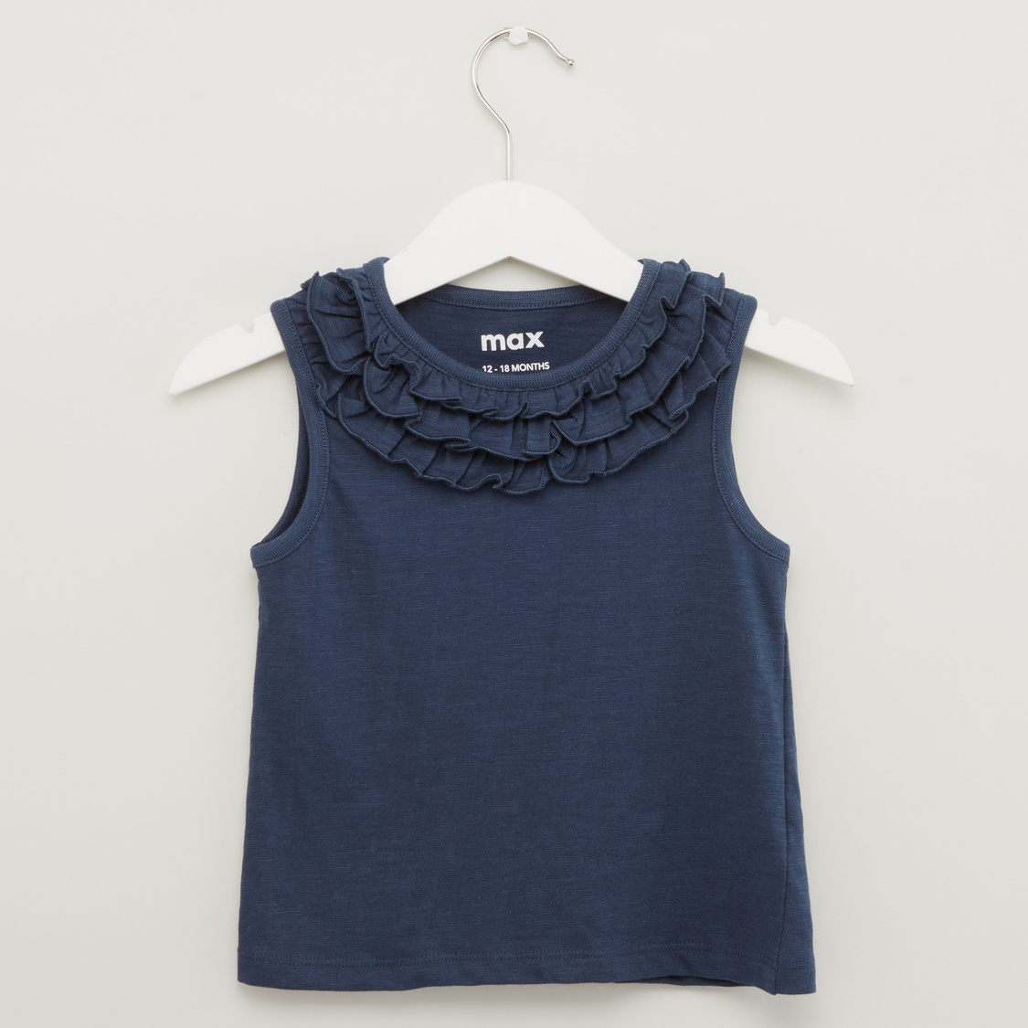 Solid Sleeveless Top with Ruffle Detail
