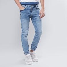 بنطلون جينز سكيني بخصر متوسط الإرتفاع
