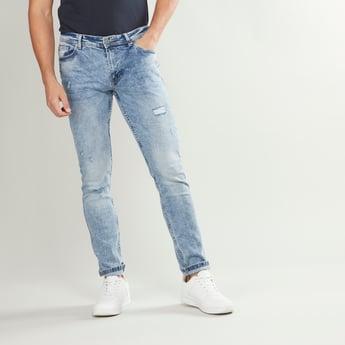 بنطلون جينز بقصة سليم وخصر متوسط الارتفاع وجيوب