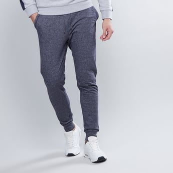 Textured Mid Waist Jog Pants with Drawstring and Pocket Detail
