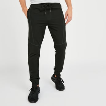 Slim Fit Textured Mid-Rise Jog Pants with Pocket Detail and Drawstring