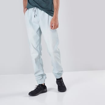 Slim Fit Mid-Rise Cuffed Joggers with Drawstring Closure.