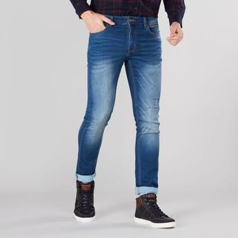جينز طويل سليم بخصر متوسط الارتفاع وتفاصيل جيوب