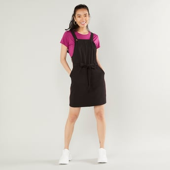 Solid Midi Sleeveless Pinafore with Tie Ups and Pocket Detail