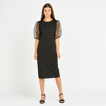 فستان ميدي واسع سادة بياقة مستديرة وأكمام منفوخة