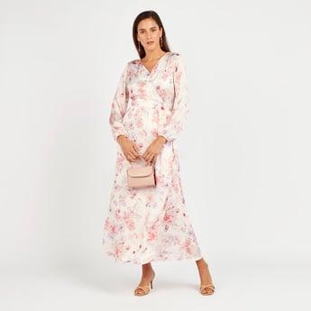 فستان طويل ملفوف بأكمام فانوس وطبعات أزهار