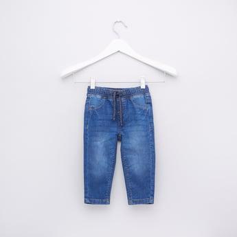 بنطال جينز بخصر مطاطي وجيوب ورباط