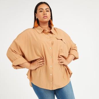 قميص طويل سادة بأكمام طويلة وتفاصيل جيوب