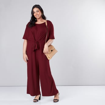 Ribbed Jumpsuit with Short Sleeves and Tie Ups