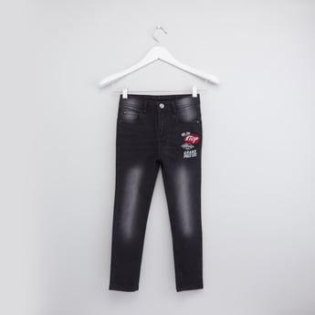 بنطال جينز طويل بجيوب وطبعات
