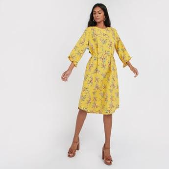 فستان إيه لاين متوسط الط��ل بأكمام 3/4 وأربطة وطبعات أزهار