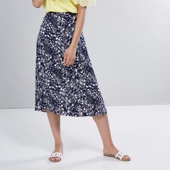 تنورة متوسطة الطول بأزرار وخصر مطّاطي وطبعات زهرية