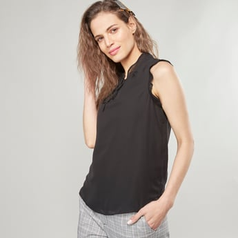 Textured Sleeveless Top with Ruffled Collar and Tie-Up Detail