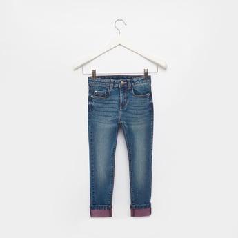 بنطلون جينز ممزق بجيوب وحلقات للحزام