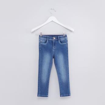 بنطال جينز طويل بزر وجيوب وتطريز