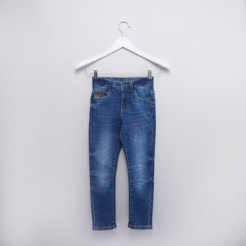 Whiskered Jeans with Pockets and Button Closure