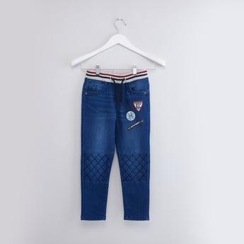 بنطال جينز طويل بجيوب وحلقات للحزام
