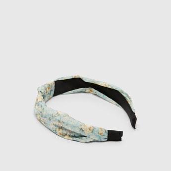 شريطة شعر بعقدة وطبعات أزهار