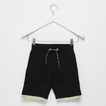 Solid Shorts with Pockets and Patterned Hem