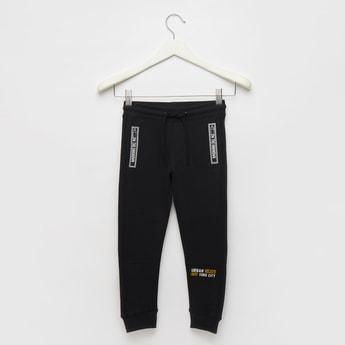 Text Print Jog Pants with Zippered Pockets and Drawstring Closure