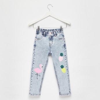 بنطلون جينز مزين بترتر وبجيوب