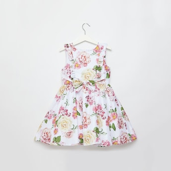 فستان دون أكمام بطول الركبة بفيونكة وطبعات زهرية