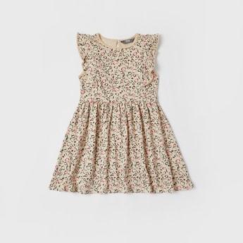 فستان بطول الركبة وطبعات