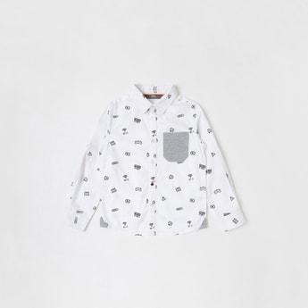 قميص بأكمام طويلة وتفاصيل جيب وطبعات