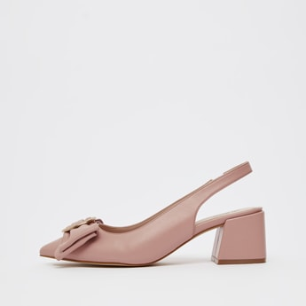 Solid Mules with Elastic Closure and Bow Accent