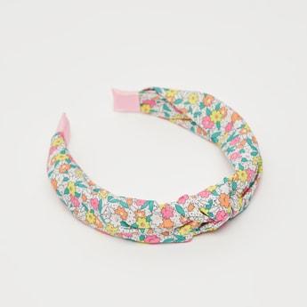 ربطة شعر ملتوية بطبعات أزهار