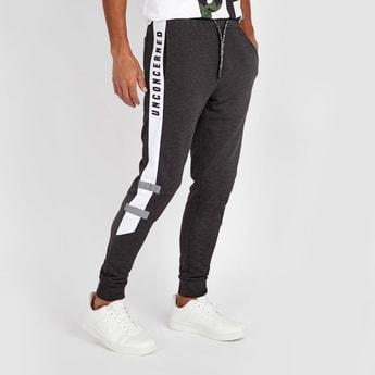 Slim Fit Textured Mid-Rise Jog Pants with Pocket Detail