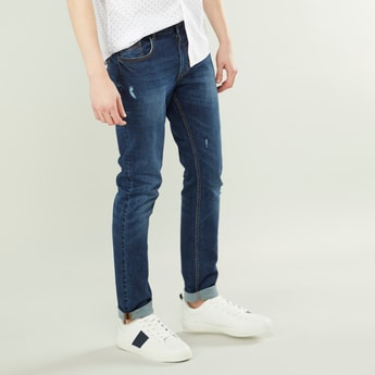 Fashion Washed Slim Fit Ripped Jeans with 5-Pockets and Button Closure