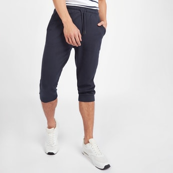 Solid Mid-Rise 3/4 Jog Pants with Pocket Detail